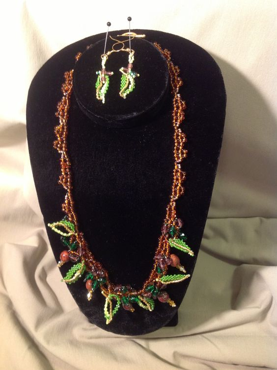 """""""Rain Forest"""" Beautiful semi-precious stones, Delica beaded leaves, Swawrovski crystals, complete with leaf earrings, 20 1/2"""".  Original design, one of a kind.  Email: gracebeadeddesign@gmail.com"""