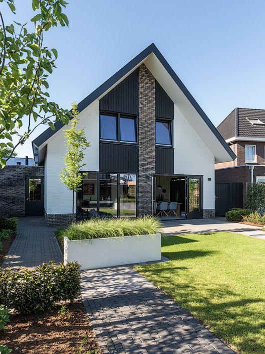 Nieuwbouw moderne vrijstaande woning in borne woningen for Moderne vrijstaande woning