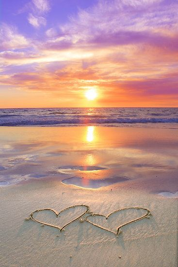 Love On The Beach At Sunset Two Heart Shapes With And Reflections In Water