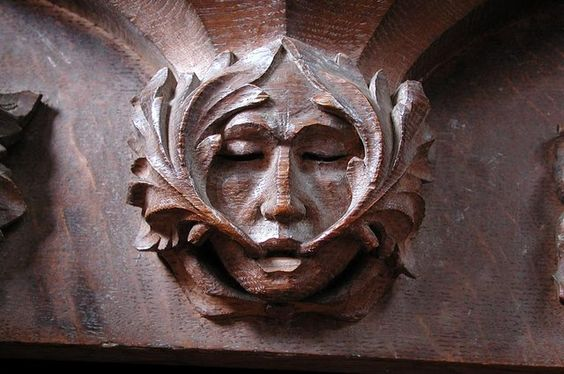 St Mary, Adderbury, Oxon - Misericord detail. Sprouts coming out of the mouth.