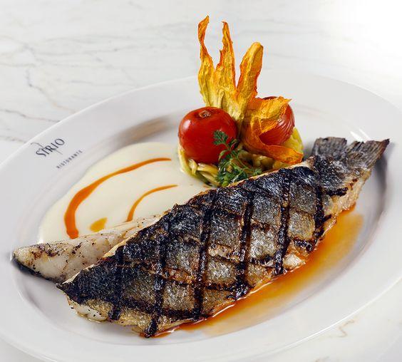 BRANZINO DI ORBETELLO - Pan-Seared Imported Tuscan Sea Bass, Charred Heirloom Tomato Coulis, Fennel-Fingerling Potato Cake, Asparagus