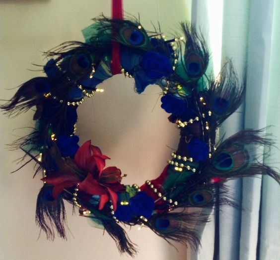 Just completed my first handmade wreath! Fabric scraps, beads, synth peacock feathers, fairy lights and hand sewn flowers.