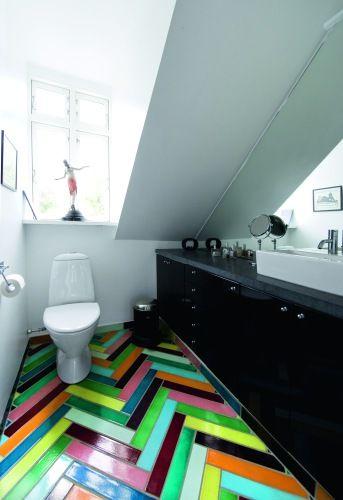bright herringbone floor in black and white bathroom