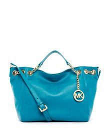Michael Kors. Im in love with my new purse. Mine is in black :)