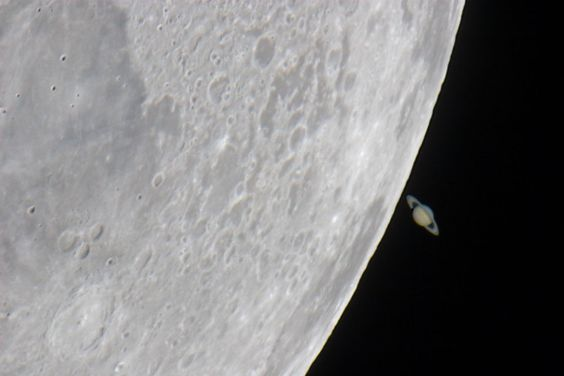 Just days after sharing the western evening sky with Venus in 2007, the Moon moved on to Saturn - actually passing in front of the ringed planet Saturn when viewed in skies over Europe, northern Africa, and western Asia. Because the Moon and bright planets wander through the sky near the ecliptic plane, such occultation events are not uncommon, but they are dramatic, especially in telescopic views.