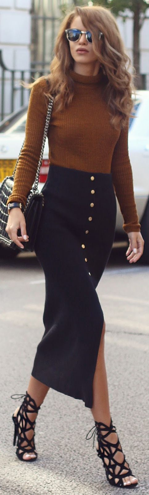 Nada Adelle wears a cute mustard roll neck jumper with her button front skirt.