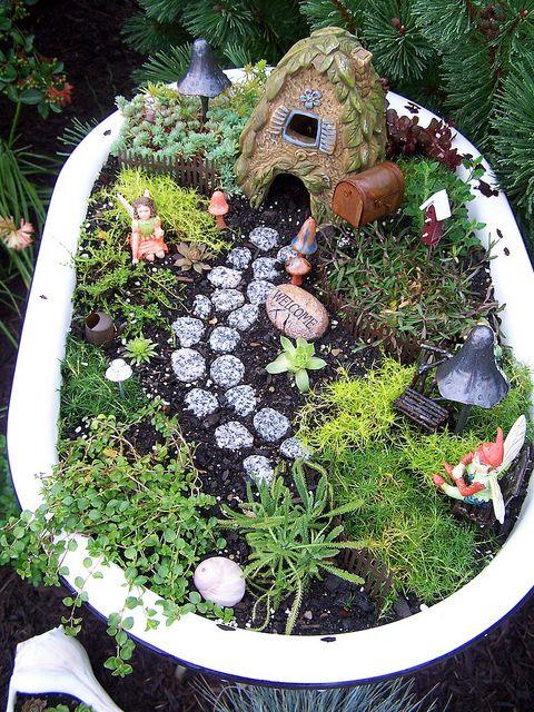 fairy garden in a bath tub