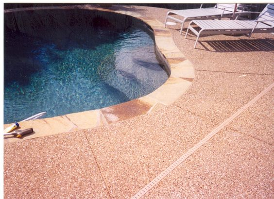 Flagstone Coping Around Pool With Exposed Aggregate Pool Outdoor Kitchen Plus Fireplace