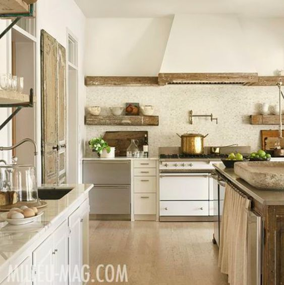 Masterfully designed French farmhouse kitchen with Lacanche range, plaster walls, antique stone sink, rustic wood beam details, and a neutral palette. Interior designer and Milieu magazine editor, Shannon Bowers created the sophisticated kitchen with pieces from Chateau Domingue. #kitchendesign #kitchendecor #frenchfarmhouse #frenchcountry #farmhousekitchen #rusticdecor #elegantdecor #oldworld #european #antiques #interiordesigner #interiordesignideas #luxurykitchen #neutralinteriors