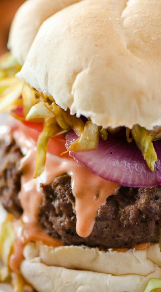 Dominican Chimichurri Burgers ~ A saucy, simply seasoned burger, topped with sauteed cabbage, tomato and onion, the Chimichurri Burger is Dominican street food at its finest!