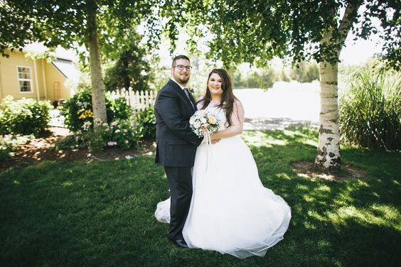 plus size bride, plus size wedding, bride and groom, barn wedding
