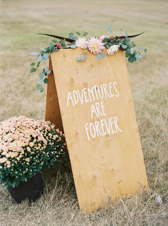 Adventures Are Forever | wedding signs - photo by Jeremiah and Rachel Photography http://ruffledblog.com/bohemian-montana-wedding