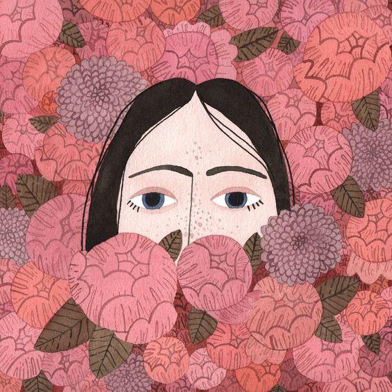Menina de olhos azuiz entre flores.