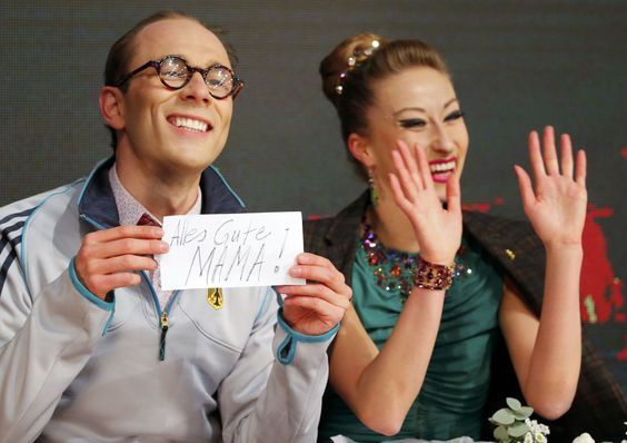 Zhiganshina and Gazsi of Germany wave after the Ice Dance Short Dance of the ISU European Figure Skating Championships in Budapest