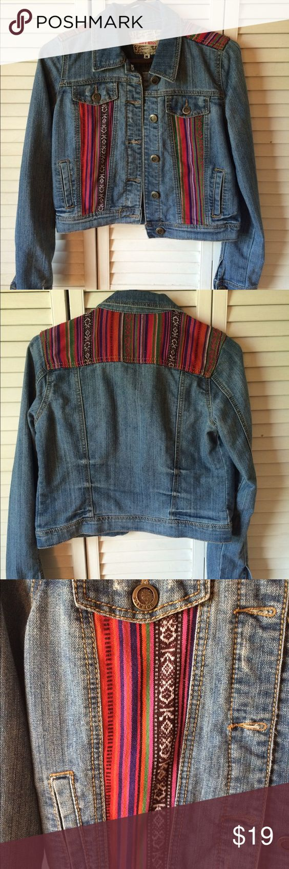 Womens Hotkiss Aztec Jean Jacket This jean jacket is perfect for pairing with a dress or your favorite white tank top and jeans. Accented with colorful aztec patterns, button sleeves and pockets for carrying all of your important items. Hot Kiss Jackets & Coats Jean Jackets