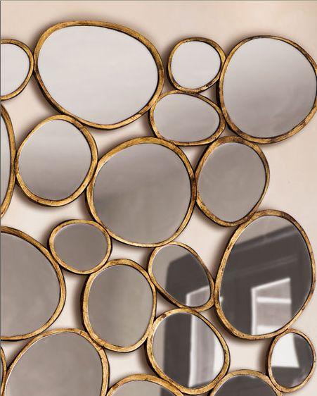 Pebble shaped mirrors.