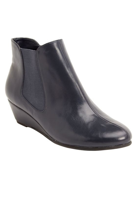 We love this chic #MeghanTrainor pick! This attractive, convenient slip-on bootie will have you looking sharp no matter what. Not only chic, this wedge bootie is also comfortable and complete with CV Flex Contour by Comfortview® technology including a shock-resistant heel, so you can step with confidence wherever you go!