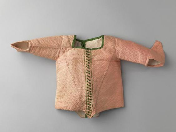 Infant's jacket for a girl, 1750-1780. Pale pink figured silk, trimmed with green silk ribbon around the neckline, white linen lining.