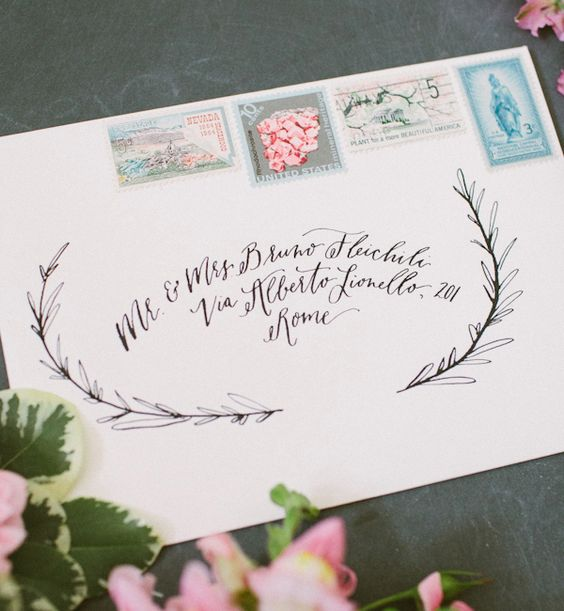 Vintage stamps and proper paper specification are the perfect way to continue the overall theme and color palette in an invitation suite.