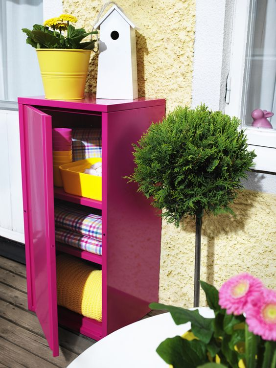outdoor storage, something similar for inside entrance, in front of wall with pot plant and hose reel, pop of colour?