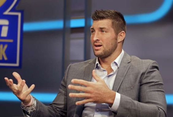Tim Tebow answers a question during an interview on the set of ESPN's new SEC Network in Charlotte, N.C., Wednesday, Aug. 6, 2014.