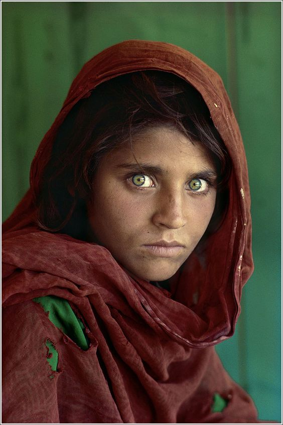 """Afghan Girl"" portrait by Steve McCurry which was featured on the cover of the National Geographic in June 1985."