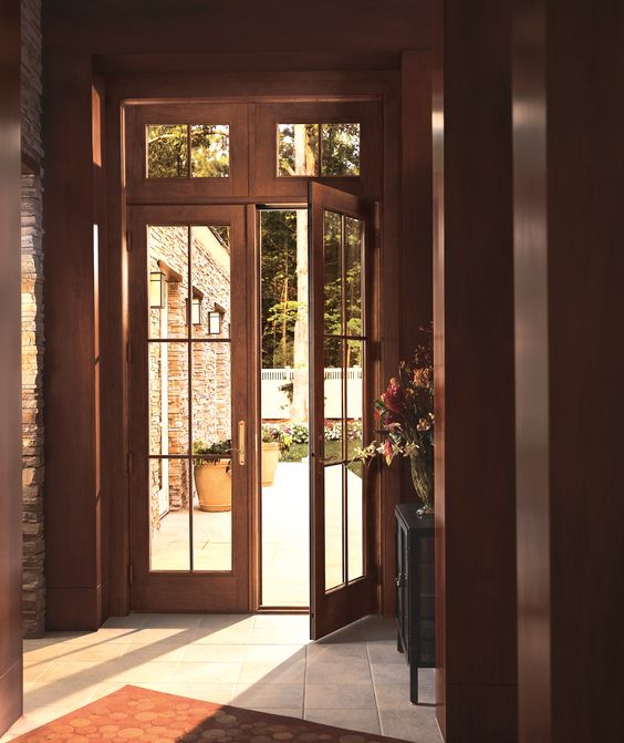 Hinged frenchwood patio doors open wide for a grand for Outside door with window that opens
