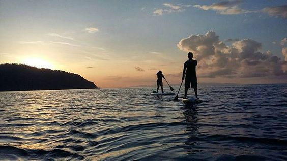The feeling of #cruising during #sunset softly on a #board over the #sea...   #CostaRica #SUP #Paddleboarding #PlayaNicuesa #NicuesaLifestyle