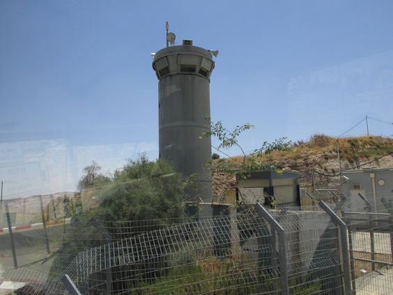 a guard tower at the entrance to the section where Palestinians live