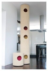 The hicat® cat climber is a floor-to-ceiling made-to-measure climbing tube with internal perches and posts, fully covered in natural coir and offering peepholes for interactive games and fun. Wow.