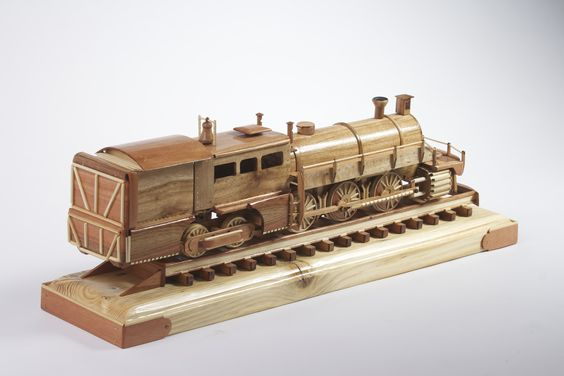Detailed scale train that I finished recently made mainly from Indian hardwood. This train is artwork and doesn't represent any particular train model. Made it purely from imagination and favorite train pictures found online. This is perfect piece for any collector that appreciate fine piece of art.