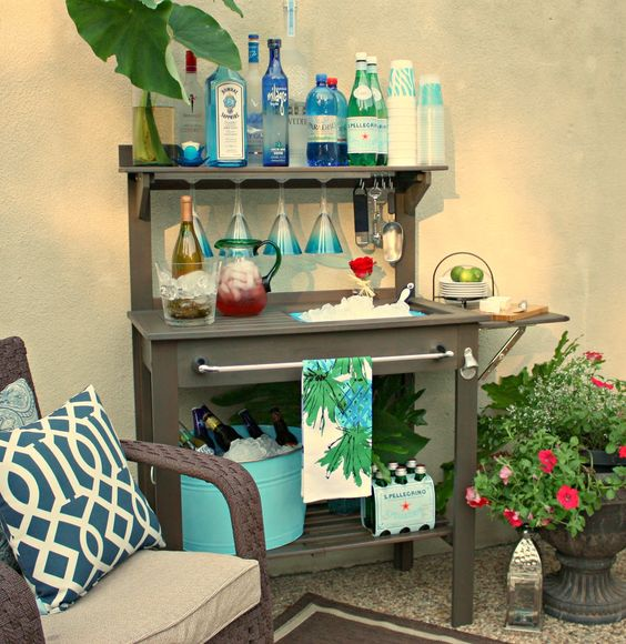 Potting Bench Turned Outdoor Bar...I am so doing this! from The creativity Exchange