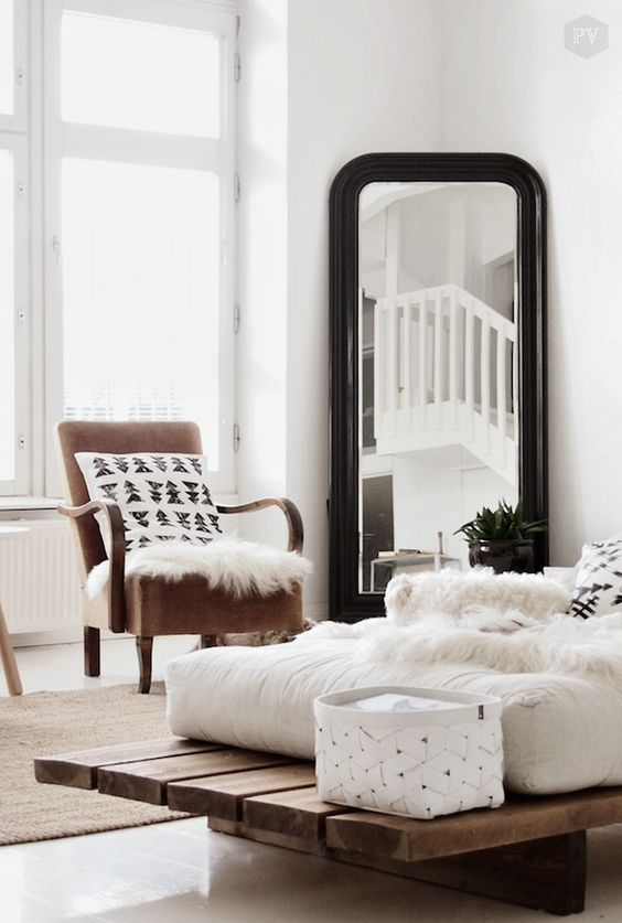 Love the large mirror in the corner of the room and a lovely seat by the window to relax with a good book: