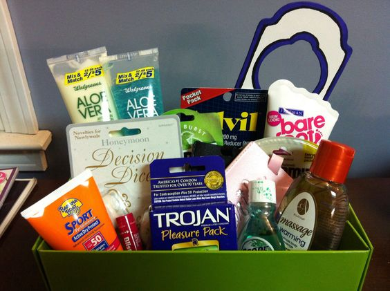 """Honeymoon Survival Kit. Includes: Suncreen, Aloe Vera lotion and gel, Advil, Dramamine, Listerine strips, mouthwash, lip balm, foot cream (my friend wore high heels on her wedding day), massage oil, honeymoon decision dice (from Party City), condoms, and bride and groom luggage tags. Also included was a """"Do Not Disturb"""" sign that I made for the occasion. I displayed everything in a box with a removable lid, using basket filler and shrink wrap. Everything could eventually fit in the box with…"""