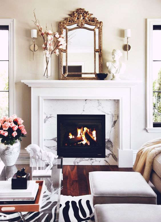 Clean, modern, and feminine take. Love the marble fireplace.: