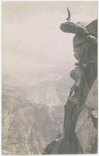 [Man doing handstand on Overhanging Rock at Glacier Point]