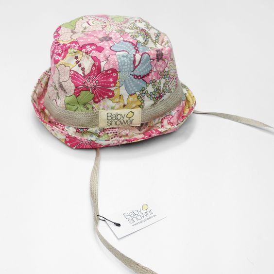 BABY SUN HAT Baby sun hat to keep the baby's face protected from the sun during the summer. It has two ribbon straps to hold the hat and prevent the baby from removing it. Available in two sizes.