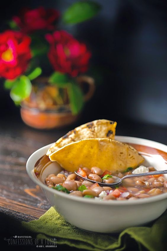Confessions of a Foodie: Frijoles de la Olla Serve with Fried Ricotta with Epazote and Green Chile added on top.