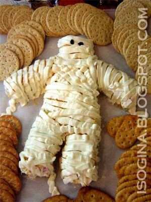 Piped on cream cheese makes the mummy strips.