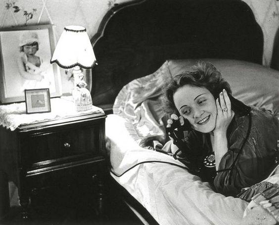 """Marlene Dietrich - in Hollywood - telephones her daughter in Berlin""  Photo: Erich Salomon (1886 - 1944 German Auschwitz concentration camp) USA - California, Los Angeles, 1930"