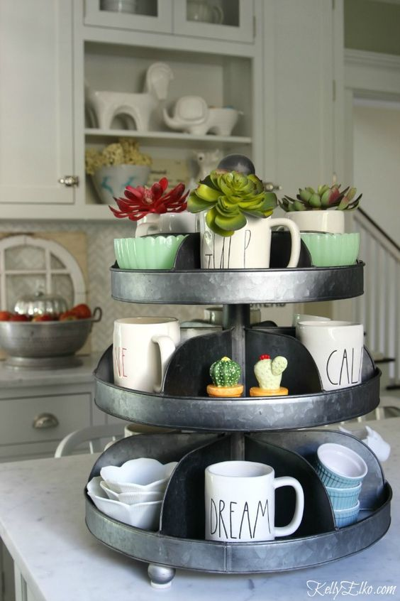 Display your everyday items in a tiered tray on the kitchen counter eclecticallyvintage.com
