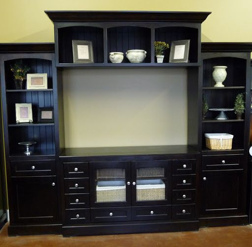 Love this large entertainment center. Maybe not black though.. http://www.incognitocustomclosets.com