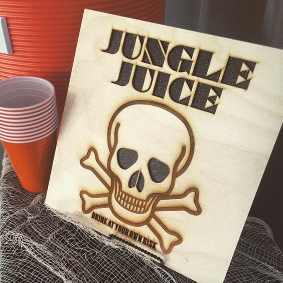Need a fun custom sign for a party?! Everyone raved over this awesome #lasercut and etched sign for the infamous Jungle Juice at our annual Halloween Party! #glitterskull #halloween #halloweenonchurchill #holyhalloween2015 #nothingisordinary #LiveColorful