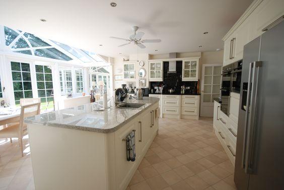 kitchen with Colonial White  Black Granite worktops by Saffron