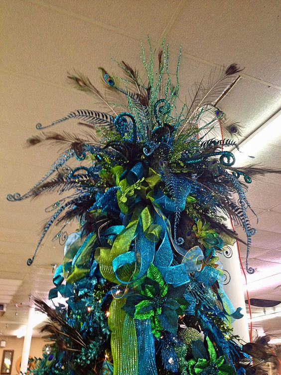 Peacock Christmas tree topper. My mom needs this for one of her trees. #fabrics #haberdashery #fabricworld