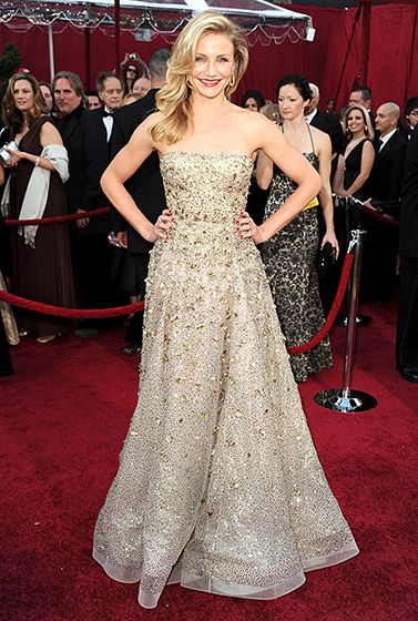 Cameron Diaz actress dazzled on the red carpet at the 2010 Oscars in a gold strapless gown with beaded embroidery.