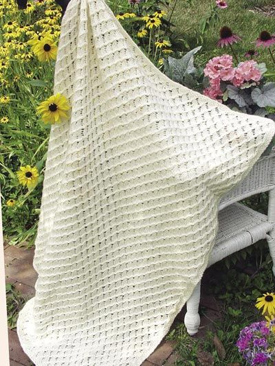 The Sweet Dreams Afghan is soft enough for any baby and beautiful enough for anyones lap.  This free baby blanket knitting pattern is available to download. Freepatterns.com