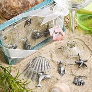 Heading for the beach? Your family and friends will be charmed by these unique beach pewter seashell themed wine charms.