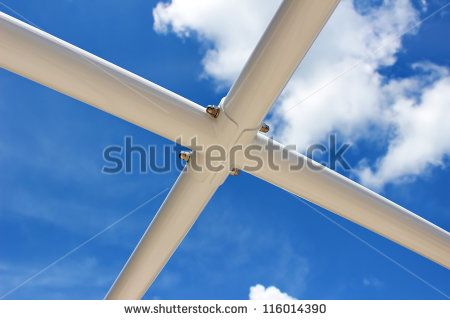 Sun shade steel structure with blue sky background - stock photo