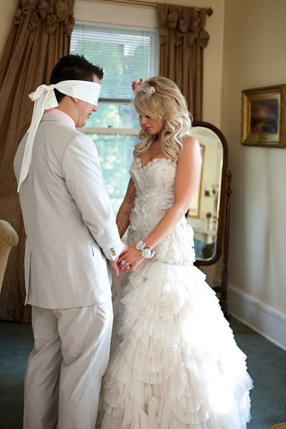 praying together before the wedding while he's blindfolded...so sweet and special.: